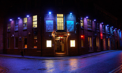 Cold Light  It is amazing how lighting can affect the feel of a photo. This is a Russian Vodka bar in town that I shot this evening. I don't know if they're trying to create a Siberian ambience for this place, but even on a warm Summer evening it looks freezing cold round here. Suffice to say that it actually was bitterly cold this evening, it wasn't just the lighting!