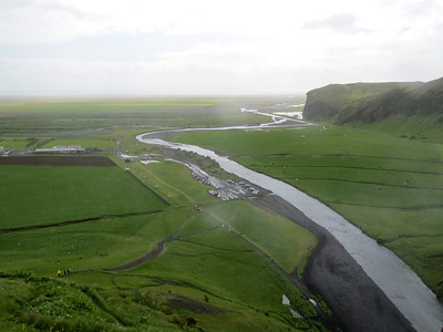 The glacier fed river flowing towards the North Sea on the south coast of Iceland. The campground is in the center. Skogar Iceland.