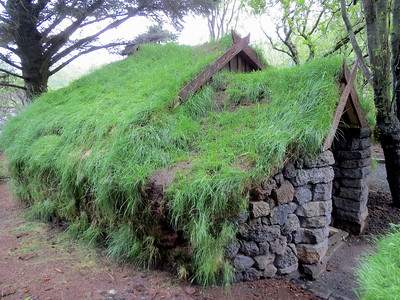 A small turf house near the campground.