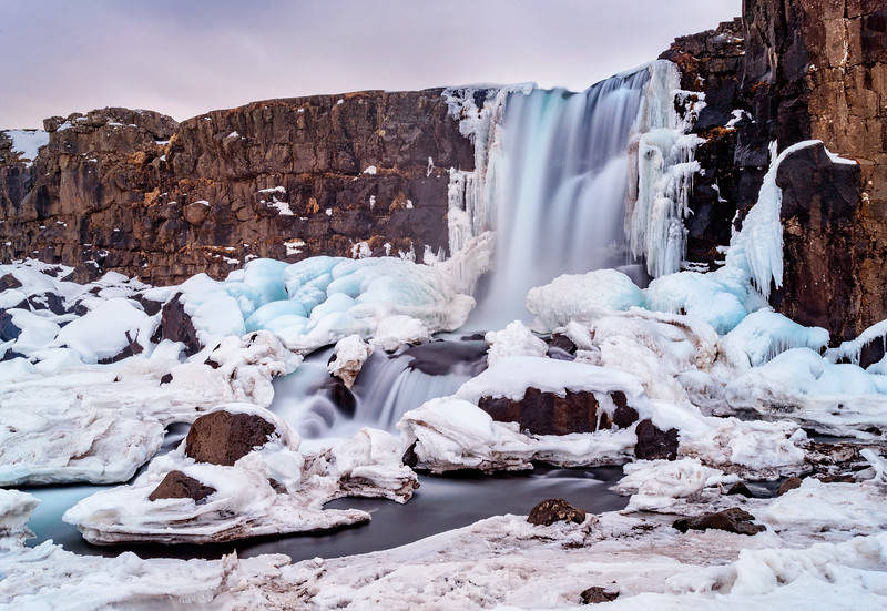 Öxarárfoss is a waterfall in Þingvellir National Park, Iceland. It flows from the river Öxará over the Almannagjá. The pool at the base of the waterfall is filled with rocks and is often extremely icy during winter.