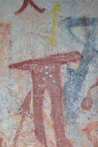 Possibly a depiction of Nu-numbi, a Shoshone tradition of a little person, strong and fearless, whom is said to either frighten people or help them find game.  Notice the use of yellow which is a less common Pictograph pigments: Yellow is made by using Limonite, a secondary mineral found in iron-rich rocks. Birch Creek Pictograph panel.  Birch Creek Valley, Idaho. 5.15.10