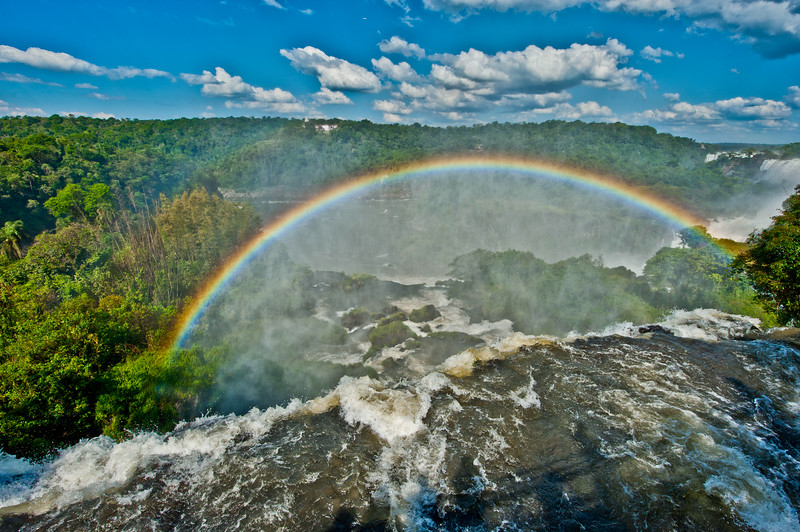 IGUAZU FALLS, Argentina 117.   Rainbows form easily when the sun's rays hit the spray and mist.<br /> Brazil side and hotel opposite.
