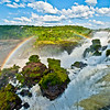 IGUAZU FALLS, Argentina 121.   Rainbows form easily when the sun's rays hit the spray and mist.