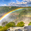 IGUAZU FALLS, Argentina 126.   Rainbows form easily when the sun's rays hit the spray and mist. Brazil on the opposite side of the river.