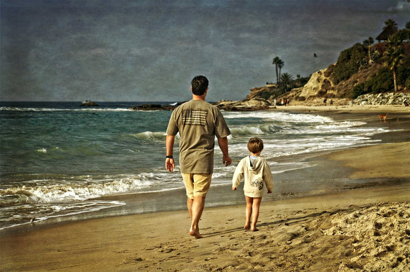 Father and son walk
