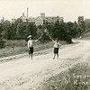 Young boys holding branches outside the Kneipp Tubercular Sanitarium,  Rome City, Indiana.  Ca. 1910.  RPPC