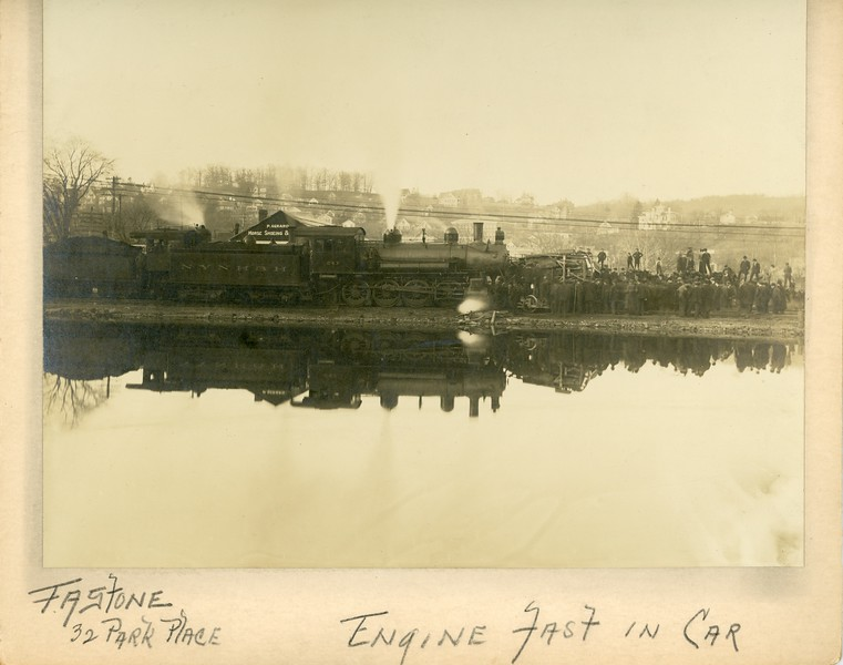 "Train wreck, Waterbury, CT, ca. 1910, notation, ""Engine Fast in Car"".  Ptgr:  Fastone, 32 Park Place, Waterbury. MP AP"