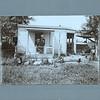 Civil War veteran in front of his home, ca. 1885.  MP AP