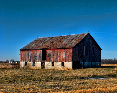 A stately old barn, with the winter winds whistling through, stands tall outside of Jamestown, OH