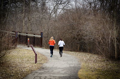 Girls running in Parker Mill Park