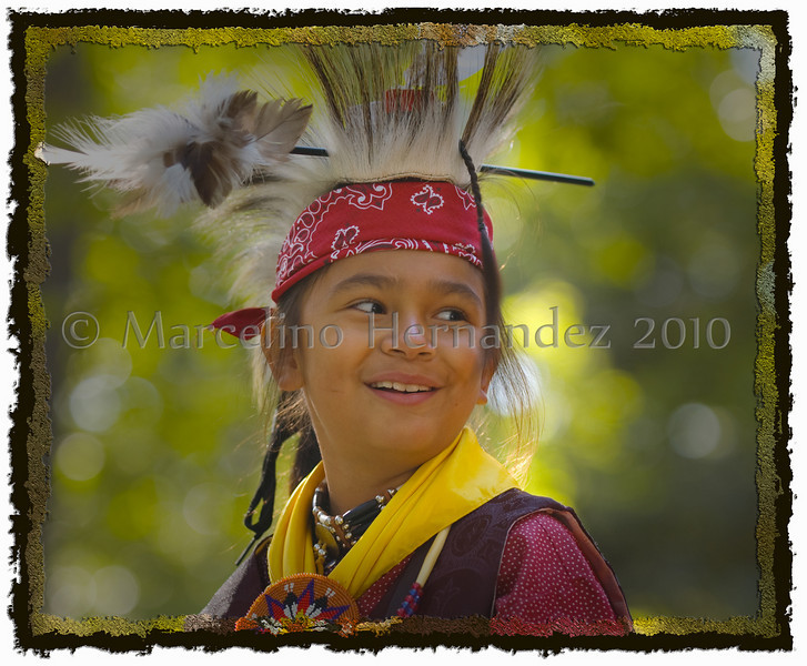 Zion Pow wow 2009. He entered a dance competition. Even though it was a serious dance he was still a kid and enjoyed playing afterwards!