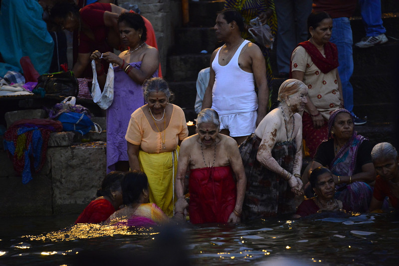 Going for a dip in the Ganges in Varanasi