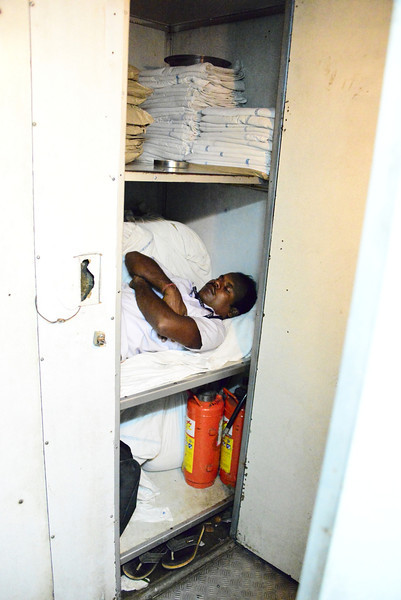 On the train, the guard takes a nap ... in the laundry cupboard!