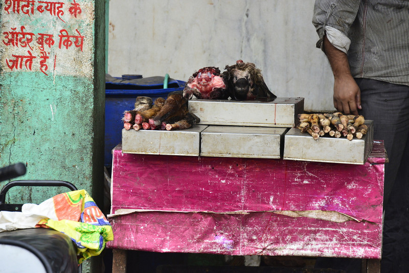 Street butcher - whole animal heads and legs with the fur still on!