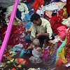A well near where i'm living in Varanasi is host to thousands of saris, thrown away by women wishing for fertility and healthy babies. After purifying themselves in the water and putting on new saris, they leave the old ones behind.