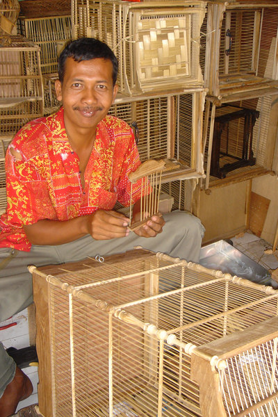 Man making bamboo birdcages in Yogyakarta, Central Java, Indonesia
