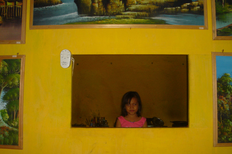 Young girl in the kitchen of Anita Restaurant, Sanur, Bali, Indonesia