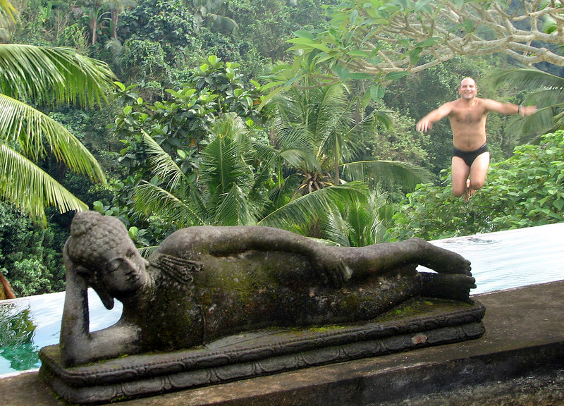 Andy Goldman leaping into the pool at Sunset Hill Villas-Spa, Ubud, Bali, Indonesia