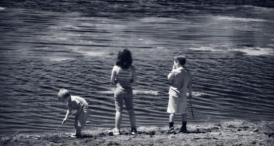 The children glow in infrared at the water's edge of Lake Simpatico in Forest Lakes, Colorado
