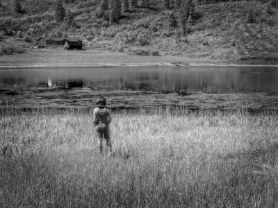 Musing in the grass on Lake Simpatico in Forest Lakes, Colorado