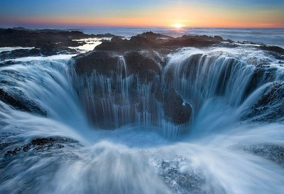 "Thor's Well - ""the gates of the dungeon."" CapePerpetua, Oregon. At moderate tide and strong surf, flowing water creates a fantastic landscape"