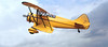 Yellow BiPlane in flight