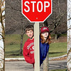 A little photo trickery of grandkids hiding behind a stop sign.
