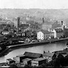 The view across the river possibly at the turn of the last century.  Stoke Bridge is to the right. The white buildings are a tide mill complex. In the centre of the picture stands St Peter's By The Quay. church.