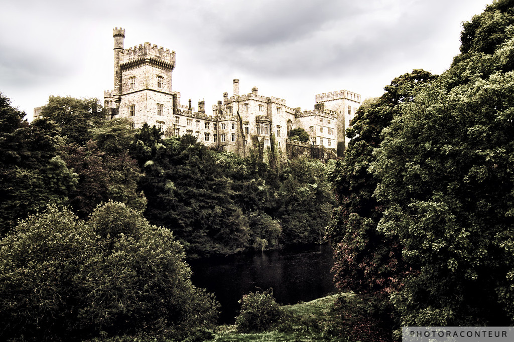 """Lismore Castle"" ~ Lismore Castle in County Waterford, Ireland, as viewed from the bridge over the River Blackwater. The castle was built in 1185 for Prince John of England while Ireland was under the rule of his father King Henry II. However, the current appearance of the castle is primarily due to significant architectural renovations in the mid-1800s under the watch of the 6th Duke of Devonshire.  Read more about Lismore Castle on IRElogue."