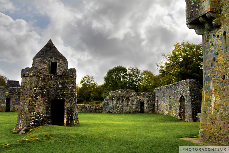 """The Watch Tower"" ~ A small watch tower marks the outside corner of the inner bawn of Aughnanure Castle in County Galway, Ireland.  Remnants of the outer wall still stand in the distance, while a small portion of the castle frames the right side of this photograph.  Built around 1500, the castle is intact, with its six stories still standing prominently on the banks of the Drimneen River. The watch tower is about 15' (5m) in diameter.    Read more on my blog, ""Galway, Part III"""