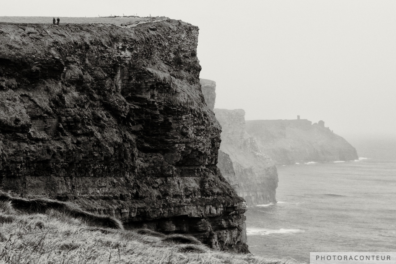 """Walking the Cliffs"" ~ A couple takes a stroll along the top of the Cliffs of Moher in County Clare, Ireland.  The cliffs rise as much as 702' (214m) above the Atlantic Ocean while stretching over 5 miles (8km)."