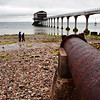 Bembridge RNLI with rusty pipe, stony beach and some people
