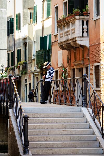 Venice, Gondola driver on bridge