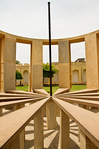 "Jantar Mantar, Jaipur. ""Ram yantra"" - tells the altitude and the azimuth of the sun through out the day. The cuts allow the astronomer to walk in to take accurate measurements."