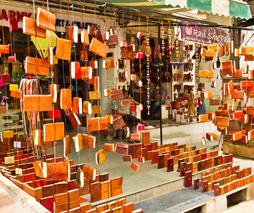 Street side shop selling camel leather bound notebooks. Udaipur.
