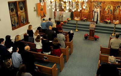 The Rev. Bosko Stojanovic leads the annual Christmas Eve Vesper on Jan. 6 at Saint George Serbian Orthodox Church, in Lorain. KRISTIN BAUER | CHRONICLE