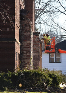 KRISTIN BAUER | CHRONICLE Construction crews remove the sandstone archways located at the main entrances at McCormick on Tuesday afternoon, Jan 5. The sandstone archways will be preserved; one will be moved to the new school and another will be placed in the park once McCormick is razed.