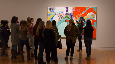 Docent explains the political implications of Janvier's art