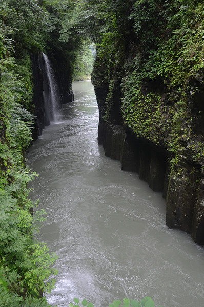 Takachiho Gorge, central Kyushu, formed as flowing water slowly cut down into the surrounding lava rock.<br /> <br />  Often people go down here in boats to enjoy the waterfall close up, but it was still early so no one was renting them yet.