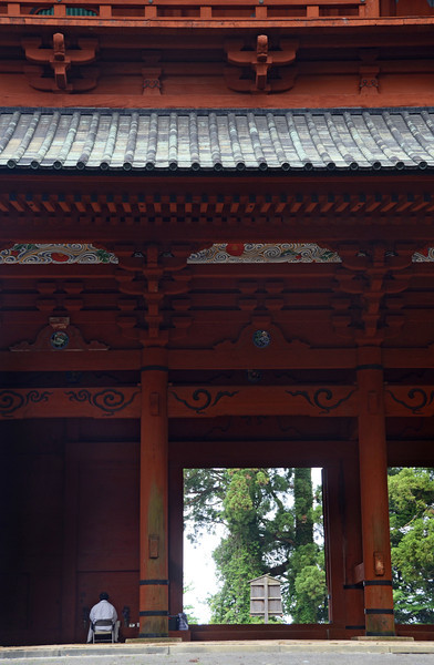 Man reciting Buddhist scripture at Mt. Koya's main gate.
