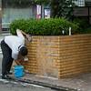 Fukuoka: restaurant worker scrubbing his wall