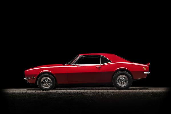1968 Red Chevy Camaro at night.