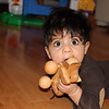 Jayden eating his wooden doggy.