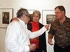 Photography reception of Jim Marshall at Gallery 291, 291 Geary St., San Francisco<br /> • Left, Jim Marshall; Center, folk singer Joan Baez