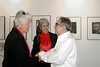 Photography reception of Jim Marshall at Gallery 291, 291 Geary St., San Francisco<br /> • Jim Marshall, right and Joan Baez, center