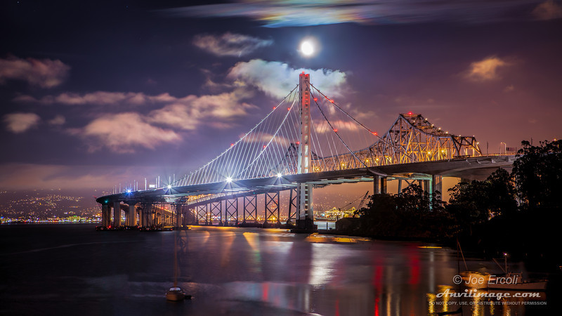 After finding out that the new SF-Oakland Bay Bridge opened hours ahead of schedule, I grabbed my gear and drove up to Yerba Buena Island to get this shot as soon as I could.