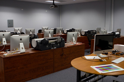 The classroom has large screen iMacs and large format printers.