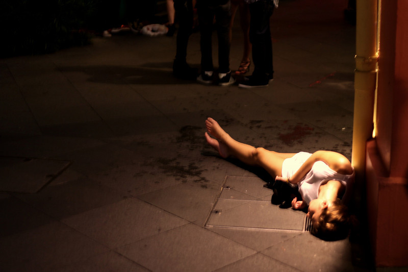 12am - Drunken girl ends up lying down on the pavement in her own puke<br /> Clarke Quay, Singapore<br /> 03/2010