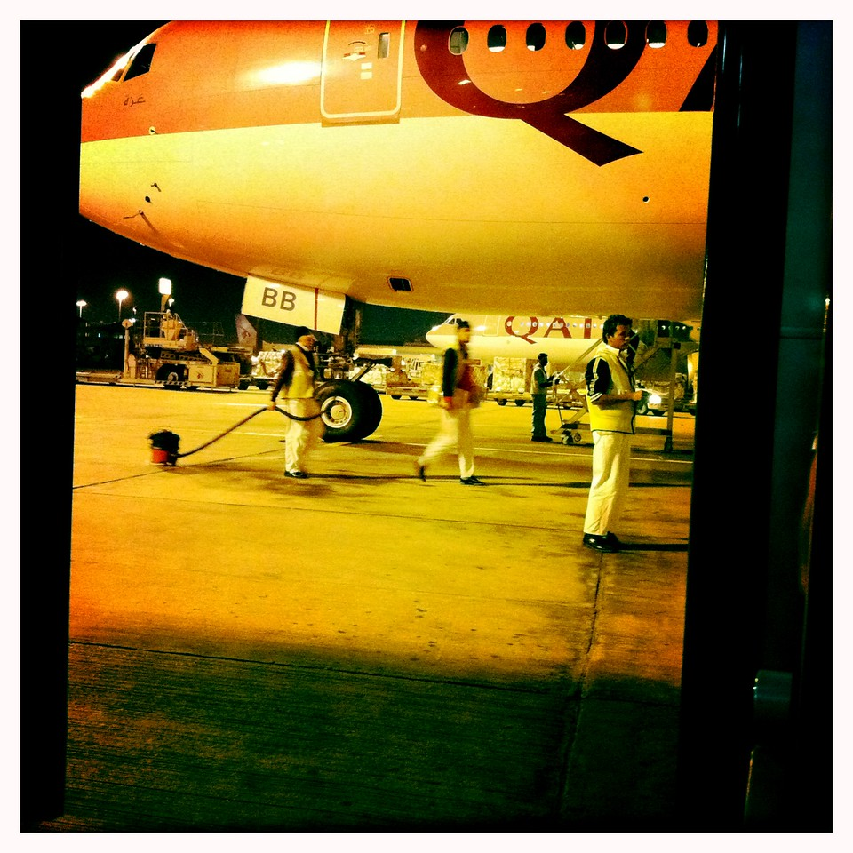 2am - Cleaners waiting for access one of Qatar Airways Boeing 777.<br /> Doha, Qatar<br /> 02/2012<br /> iPhone