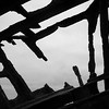 Torn sky. Staring up through the Peter Iredale shipwreck.<br /> Oregon, USA.
